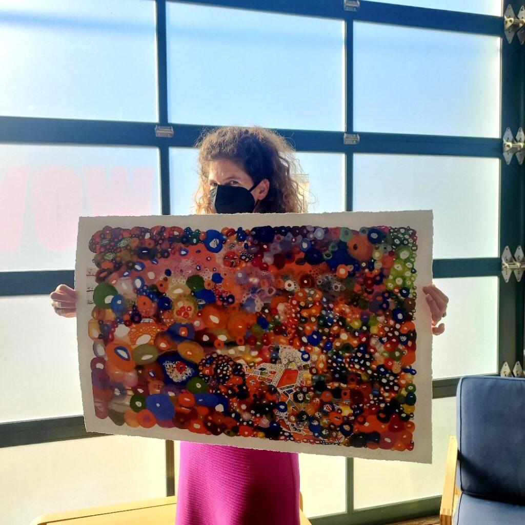 Sarah Jane stands with artist proof of SJL's Map of Prague